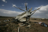 A stripped tree is wrapped in metal remnants in Windsor, Colo. on Thursday May 22, 2008.  Multiple...