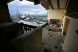 The back end of the Anna Montes and Jose Brito's home is all opened up from the tornado in...