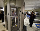 TSA transportation security officer Evelina Ahsan, right, watches a L3 Company model, (she would...