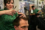 (069) Mark Mullis of Denver gets his wedding haircut at his favorite barbershop, the original...