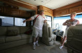 Linda Gahagen and Lenny Heckman look at one of the RV models at the K&C Rv Center in Longmont,...