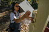 DM3420  MailBallots55379  Letter carrier Ya Lin delivers a new batch of mail-in ballots in Denver...