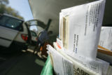 MailBallots55379  Letter carriers load boxes carrying a new batch of mail-in ballots into their...