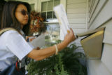 MailBallots55379  Letter carrier Ya Lin delivers a new batch of mail-in ballots in Denver on...