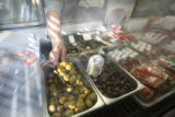 Nick Lonardo scoops up some olives for a customer at Carbone's Sausage Market and Deli on October...