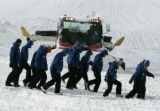 A snow cat yields to ski op workers training at Peak 8 at Breckenridge, Thursday morning November...
