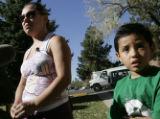 Shantel Rivas and her sion Ray,6 ,stand outside of their Peachtree apartment in Denver Wednesdday...