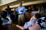 Kyle Case, 8, (cq) lays across his mother Laura's (cq) lap as they listen to United States Senate...