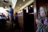 Izzy Mumm, 12, of Steamboat (cq) sips a drink as she listens to United States Senate candidate Bob...