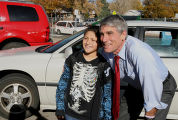 Mark Udall, running for U S Senate,gets his photo taking with 5th grade student, Alan Galvan,...