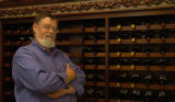 Jim Durr (cq) stands by a wine rack May 24, 2005 in his store called Surface Creek Winery &...