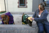 (CS1133) Jesse Lucio, adjusts the hat on Grizzly, dressed as Brett Favre, at Howlween, a canine...