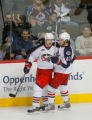 DM5256  NHLxxxAvsxxBluexxxJacketsxx55445 Columbus Blue Jackets defenseman Jan Hejda #8, left, and...