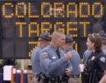 Colorado State Patrol Sergeant Tim Keeton (cq), left, talks with Ft. Collins Police Department...