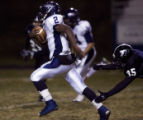 Columbine's Demetrius McDondle breaks away from Pomona's Tanner Ryan to score a touchdown and put...
