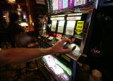 Playing the slot machines at EZ Street Casino Nick Trujillo of Westminister is in favor of the...