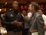 (LEFT-in police uniform, bald african american gentleman) Denver Deputy Sheriff Sgt. Darryle...