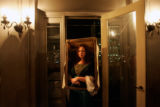 (CS0192) Halloween reveler Becca Stock, dressed as Mona Lisa, hangs out in the D&F Tower at a...