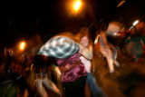 (CS0305) Halloween revelers take part in a pillow fight at the intersection of 15th and Larimer in...