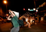 (CS0347) Halloween revelers take part in a pillow fight at the corner of 15th and Larimer in...