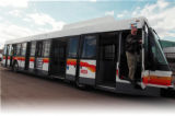 Dale Hill, president of Trans Teq, stands by a new hybrid shuttle bus, which RTD will use on the...
