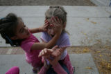 Carmen Cutrona, 5, (cq) covers the eyes of Mia Kieling, 6, (cq)while playing a game on the...