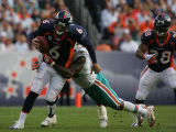 (CS0049) Jay Cutler is sacked by Joey Porter in the second quarter of the Denver Broncos against...