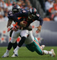(CS0050) Jay Cutler is sacked by Joey Porter in the second quarter of the Denver Broncos against...