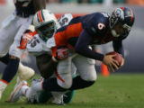 (CS0052) Jay Cutler is sacked by Joey Porter in the second quarter of the Denver Broncos against...