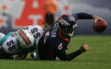 (CS0055) Jay Cutler is sacked by Joey Porter in the second quarter of the Denver Broncos against...