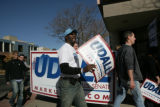 Omari Trimble (cq) walks back with supporters for United States Senate candidate Mark Udall to...