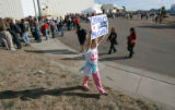 BG0021 Lyndsey Hranicka, CQ, 8, of Broomfield, colo., holds up a hand made sign as people line up...