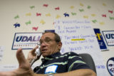 (145) Obama campaign volunteer Ron Guthrie, 63, of Golden calls out to registered democrats and...