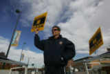 (CS0079) Denver Fire Department Captain Greg Pixley holds up sign against prop. 47, 49 and 54 at...