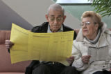 CODER109 - Husband and wife, Joesph Montes(cq), 91, and Emma Montes, (cq), 85, look over a sample...