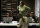 Poll supervisors Marie Baker, right, Glenda Condon, center, and Faye Cleveland, left, try and find...