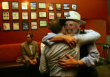 (CS0006) William Mathews, right, hugs David Koff, left as local Democrats gather to watch election...