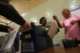 (from left) Election Ballot officials Dianah Blackwell (cq) 55, and Catharine Anderson (cq)57,...