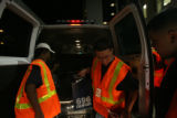 (PG1598) Workers unload final boxes of ballots to the Denver Elections Division on Tuesday night,...