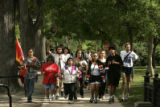 Members of the National Run for World Peace run towards the Boulder Bandshell in Boulder, Colo.,...