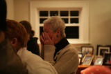 Diana Garrett (cq) of Denver wipes her eyes as she watches Barack Obama's acceptance speech on TV...