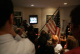 A group of citizens sing God Bless America during an election party at 2225 Dahlia street in...