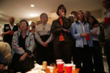 A large group watches John McCain's concession speech on TV at an election party 2225 Dahlia...
