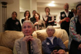 Diana Garrett (cq) of Denver wipes her eye as she watches John McCain's concession speech on TV at...
