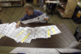 Election officials revise ballots at one of the two ''duplicate rooms'', where ballots with...