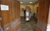 Cabinets filled with early voting ballots are moved by election officials to be placed in storage...