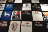 (164) Obama t-shirts fill up a wall at the Where the Buffalo Roam store on 16th Street Mall in...