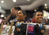 (190) Ready for a new home, Obama figurines stand next to a register at the Where the Buffalo Roam...