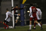 Class 5A Boys Soccer State Championship Game,Regis Jesuit's Alex Goetz lost control of the ball...