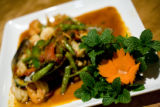 The house special, Pud Cha for $13.50 is made with scallops, mussel, shrimp, and calamari mixed...